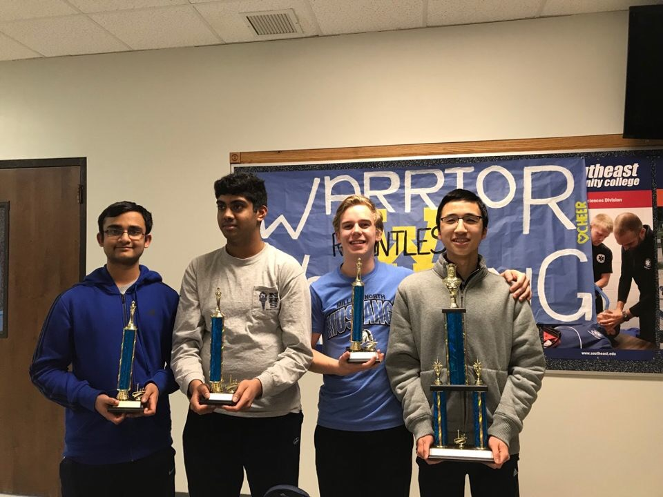 The Division 1 Team (left to right) Kailash Kalyanasundaram, Srikar Yallala, senior Kasper Hoermann, and junior Khoa Nguyen pose for a picture with their awards they won. This team swept the State competition, and they won overall.