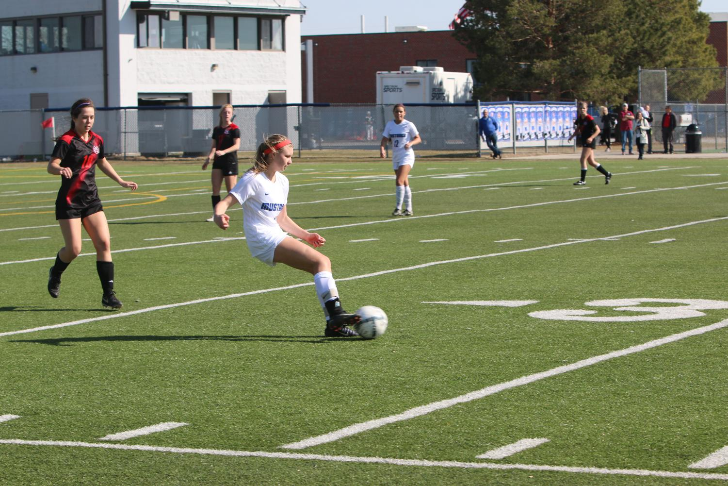 Freshman Campbell Zimmers dribbles the ball up field. The team played Westside and won the game in a shootout.