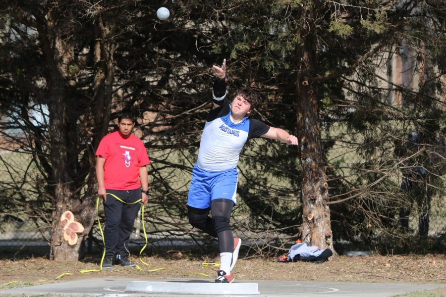 Junior Kevin Shubert throws shot put in a meet against Millard South. As a sophomore, Shubert placed tenth place at State.