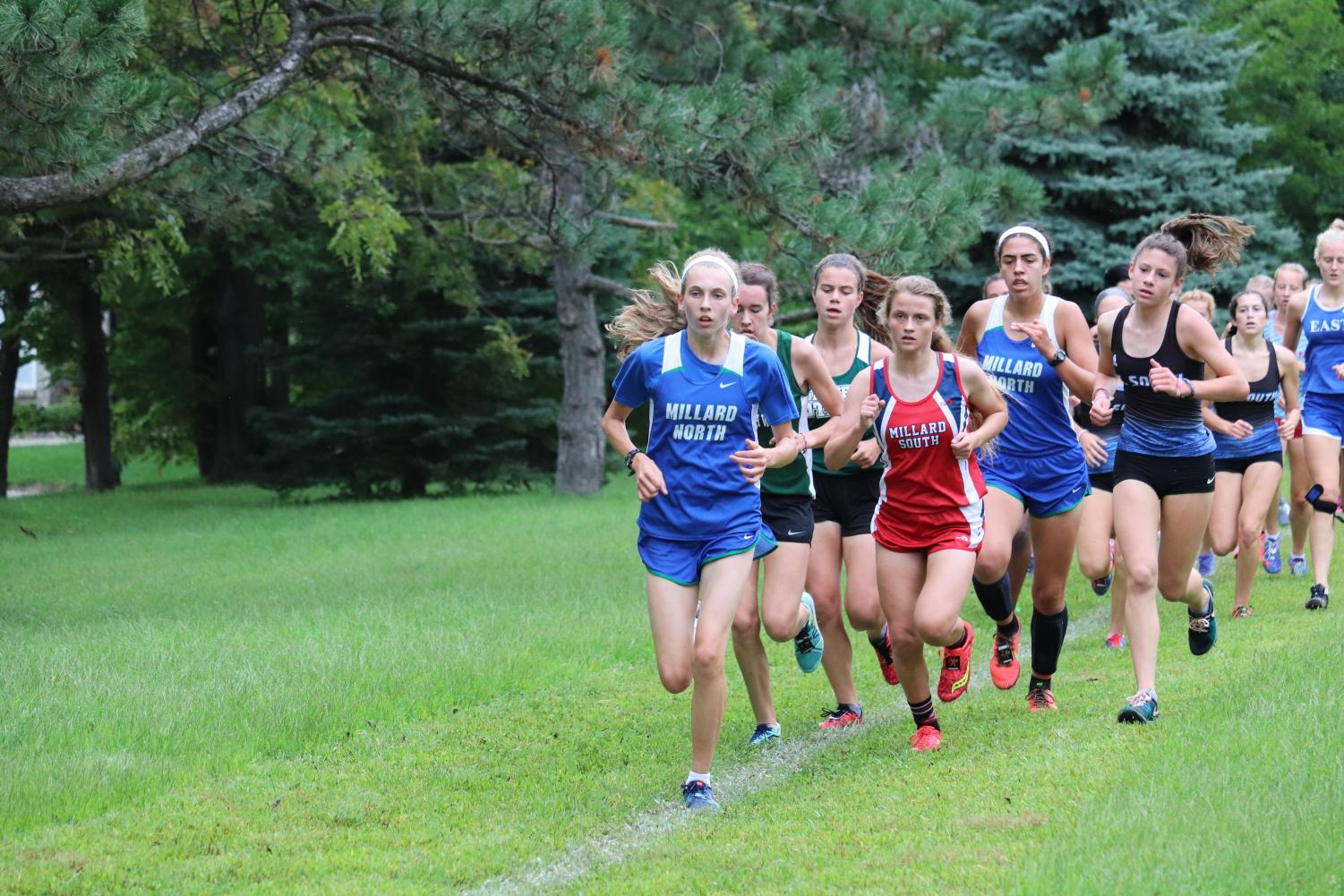 Sophomore Allison Louthan leads the pack of runners at the Millard South  Invitational on Sept.7. Individually, Louthan placed 4th overall at the meet, leading the team to an 8th place finish.