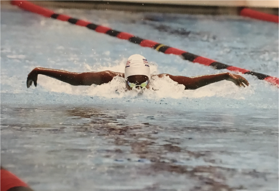 WATER WINGS:Sophomore Hannah Hailu competes in the butterfly during a 2019 meet. Hailu placed 1st in the 100 fly at the Metro Conferences, and she placed 3rd in the 100 fly and 5th in the 100 back at State.