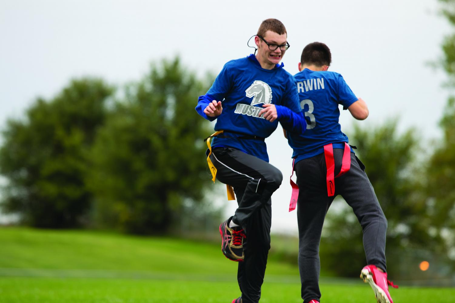 Sophomore Ryan Rauert and and 2019 graduate Zach Corwin congratulate each other on their team's touchdown. The MN Unified Flag Football team