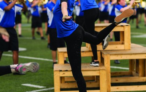 Junior Calista Rittershaus prances across the football field. Color guard has serparate practices from the marching band.